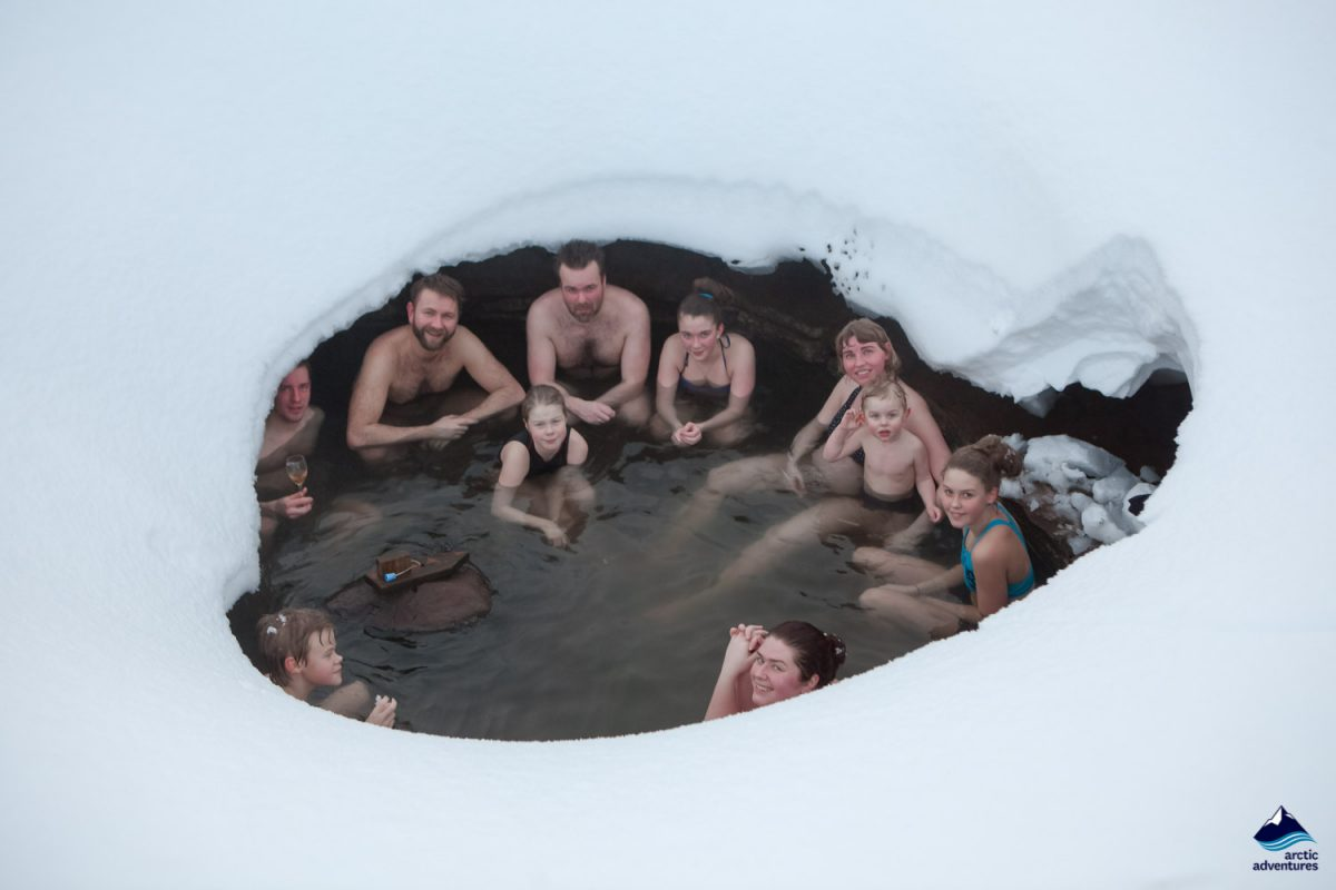 Group of people in a hot spring in winter