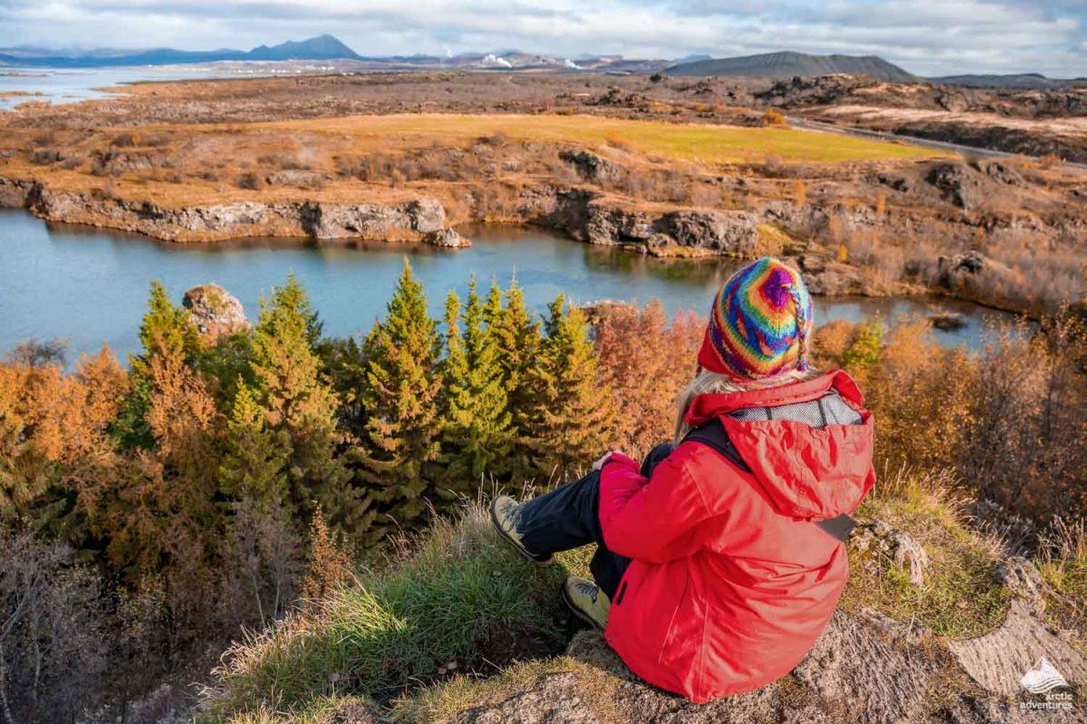 Woman admires lake Myvatn