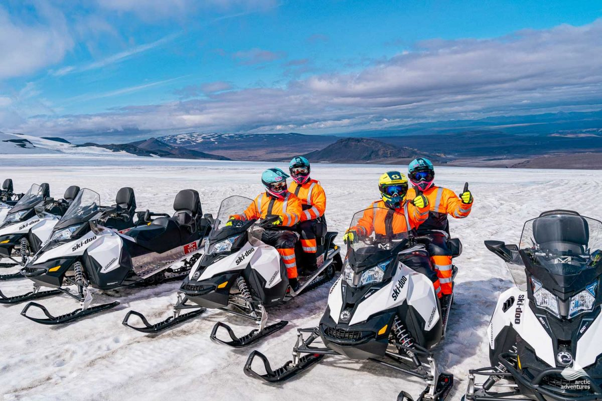 Group of people on a snowmobile