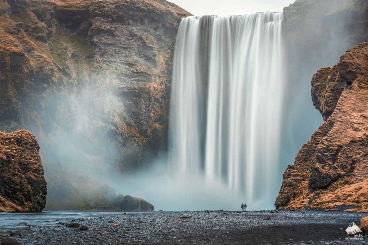 Couple of tourist near Skogafoss Waterfall