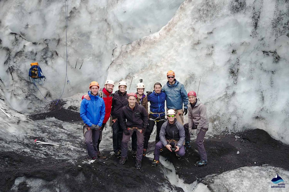 Group of people on Solheimajokull glacier in Iceland