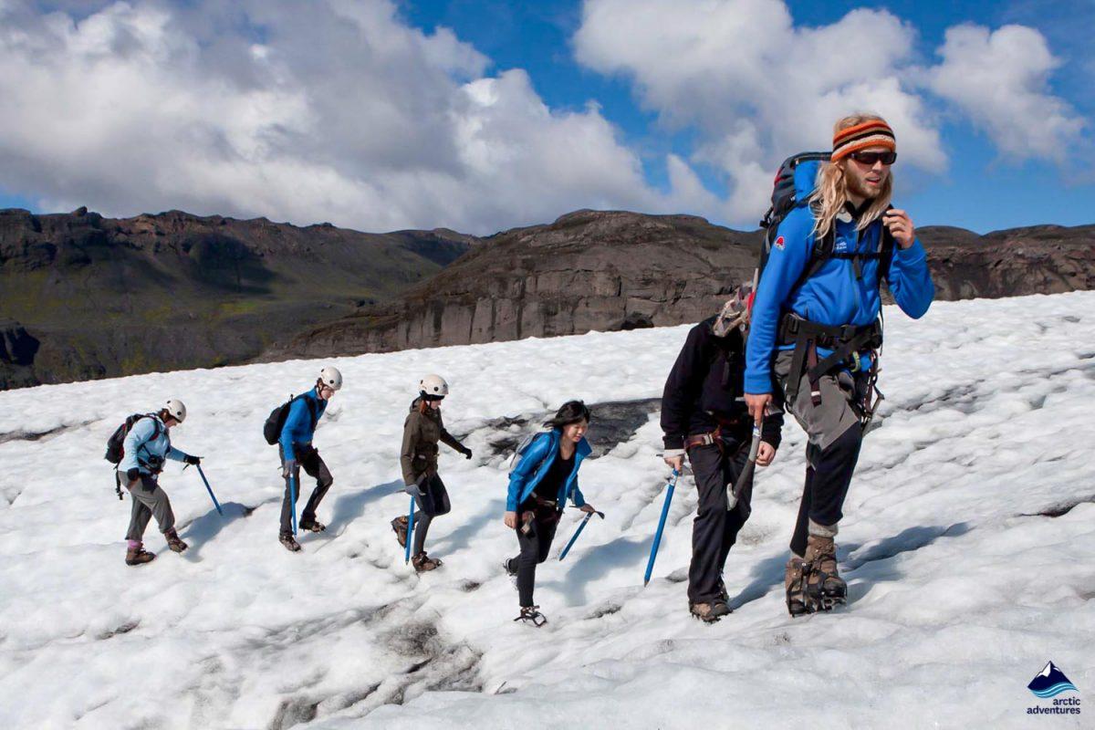 People hiking on Solheimajokull glacier