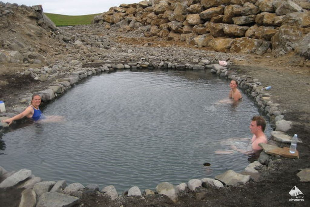 People soaking in Hveraborg hot springs