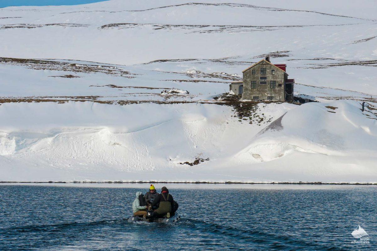 People riding boat near Kviar ski lodge